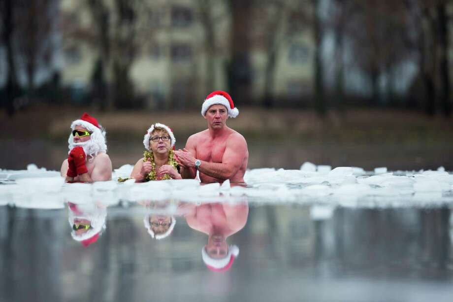 Members of the ice swimming club Berlin Seals attend the annual Christmas swimming at the partial frozen Oranke Lake in Berlin, Tuesday, Dec. 25, 2012. Photo: Markus Schreiber, Associated Press / AP