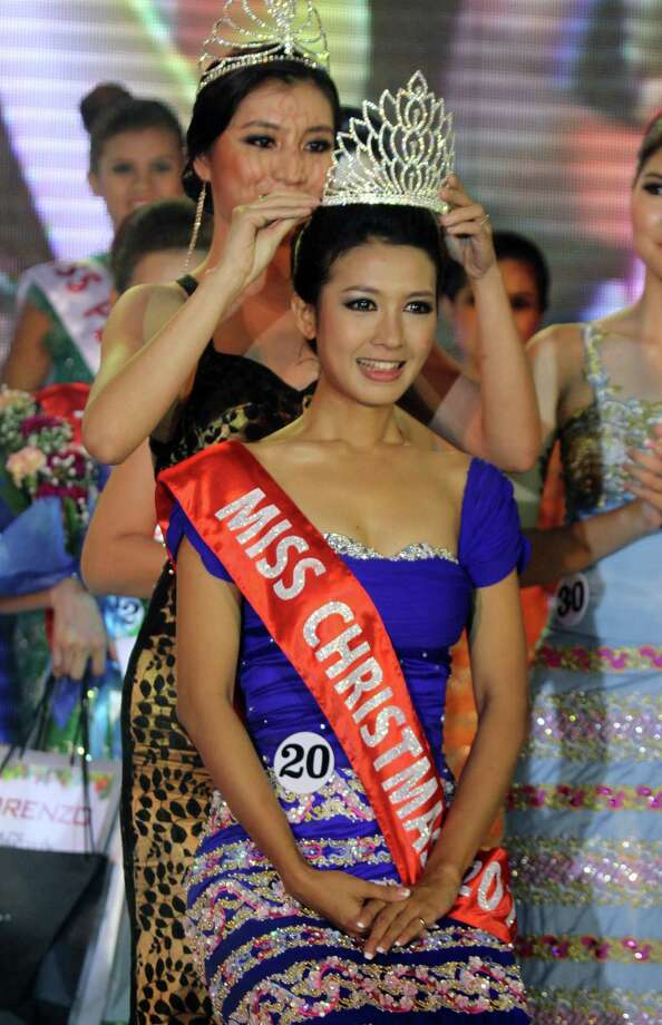 Helin Myo Ko, winner of Miss Christmas Beauty Contest, receives crown at a hotel in Yangon, Myanmar. Photo: Khin Maung Win, Associated Press / AP