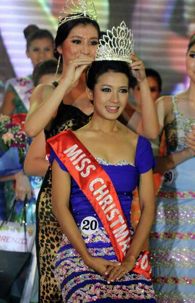Helin Myo Ko, winner of Miss Christmas Beauty Contest, receives crown at a hotel in Yangon, Myanmar.