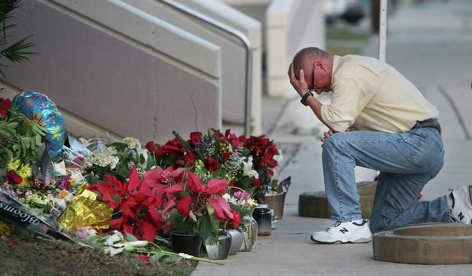 Andy Sanchez sheds a tear as he pays a tribute to long time friend, fallen Cpl. Jimmie Norman, outside the Bellaire Police Department on Tuesday, Dec. 25, 2012, in Houston. Norman was shot to death after a motorist opened fire following a traffic stop on Christmas eve. Photo: Mayra Beltran, Houston Chronicle / © 2012 Houston Chronicle