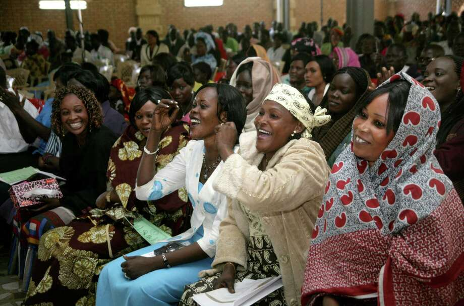 Sudanese Christians attend Christmas mass in Khartoum, Sudan, Tuesday, Dec. 25, 2012. (AP Photo/Abd Raouf) Photo: Abd Raouf