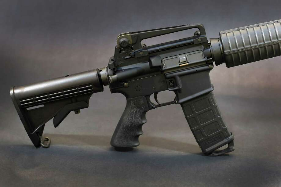 MIAMI, FL - DECEMBER 18:  In this photo illustration a Rock River Arms AR-15 rifle is seen on December 18, 2012 in Miami, Florida. The weapon is similar in style to the Bushmaster AR-15 rifle that was used during a massacre at an elementary school in Newtown, Connecticut. Firearm sales have surged recently as speculation of stricter gun laws and a re-instatement of the assault weapons ban following the mass shooting.  (Photo illustration by Joe Raedle/Getty Images) Photo: Joe Raedle