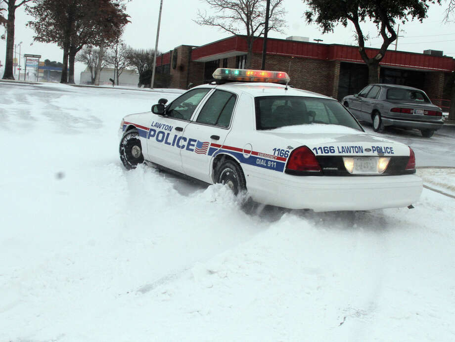 A Lawton, Okla., police cruiser tries to navigate the snow as blizzard conditions hit southwest Oklahoma at midday Tuesday, Dec. 25, 2012. Photo: Brandon Neris, Associated Press / The Lawton Constitution