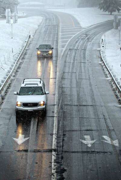 Drivers maneuver wet and icy roads in Paris, Texas Tuesday, Dec. 25, 2012 after a strong winter syst