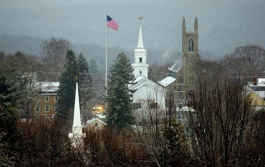 A light coating of snow blankets Newtown, Conn. Tuesday, Dec. 25, 2012. The town is dealing with the aftermath following gunman Adam Lanza's shooting spree at the Sandy Hook Elementary School on Friday, Dec. 14, that killed 26, including 20 children, before he killed himself. Photo: Craig Ruttle, Associated Press / FR61802 AP