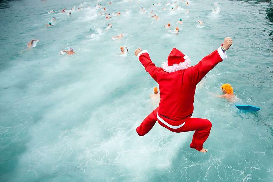 A competitor dressed up as Santa Claus jumps into the sea during the 103rd Barcelona Traditional Christmas Swimming Cup at the Old Harbour of Barcelona on December 25, 2012 in Barcelona, Spain. The Copa Nadal is organised by the Barcelona Swimming Club and involves competitors swimming across some 200 metres of water in the harbour. Launched in 1908 the event has only been suspended three times when the Spanish Civil War interrupted proceedings between 1936 and 1938. Photo: David Ramos, Getty Images