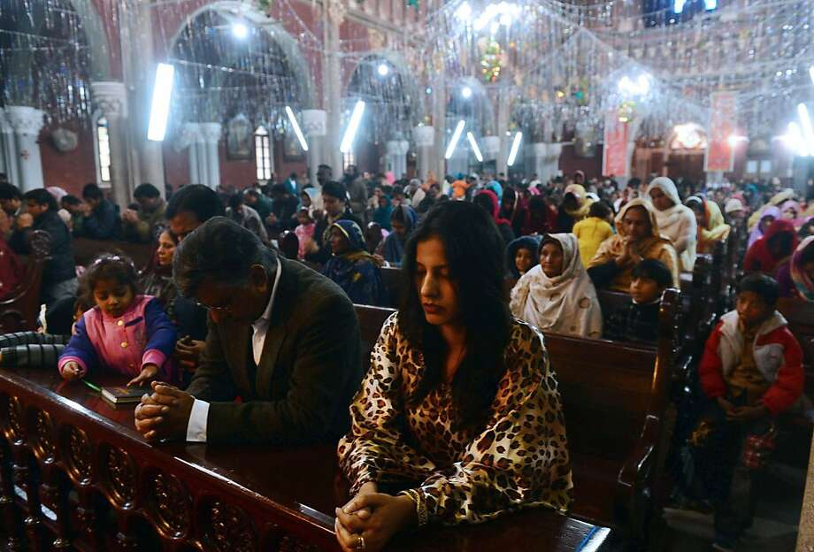 Pakistani Christians offer prayers during a Christmas mass at Saint Antony's Church in Lahore on December 25, 2012. Pakistan is overwhelmingly Muslim and at around two percent of the population, Christians are among the country's most marginalised citizens. Photo: Arif Ali, AFP/Getty Images