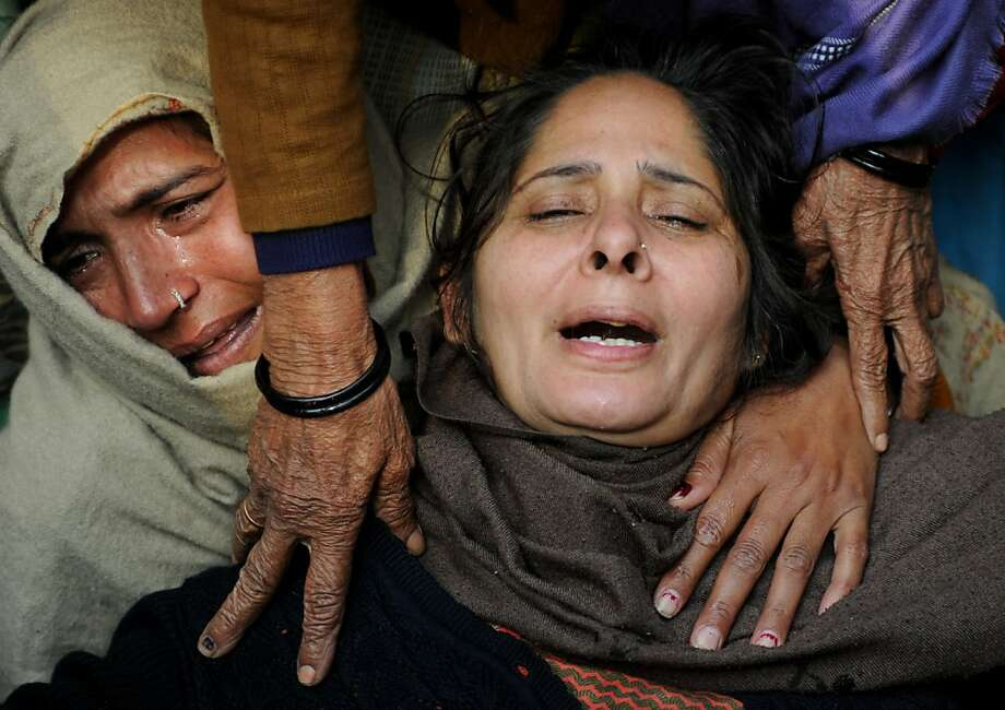 Relatives of Indian policeman Subash Tomar mourn during his funeral in New Delhi on December 25, 2012.  Tomar, a 47-year-old constable Indian policeman who was injured in clashes during a protest over a gang-rape in New Delhi has died. Tomar, a 47-year-old constable deployed at the India Gate monument on December 23 to control the protests, was beaten up by a mob and rushed to hospital by the police. Photo: Sajjad Hussain, AFP/Getty Images