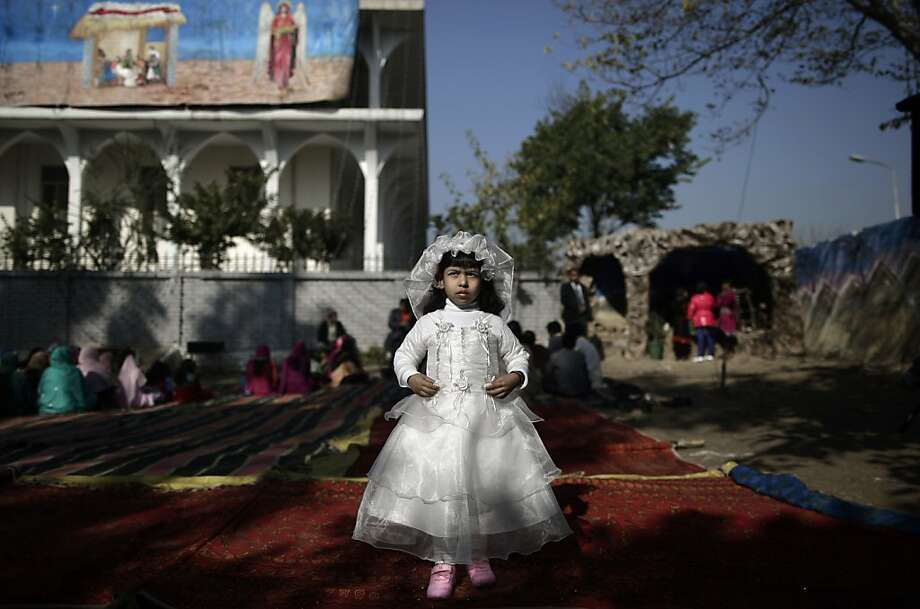 Pakistani Anusha Khalid, 4, dressed as a bride, poses for a picture at an outdoor Mass on Christmas Day, in a Christian neighborhood in Islamabad, Pakistan, Tuesday, Dec. 25, 2012.  Photo: Muhammed Muheisen, Associated Press