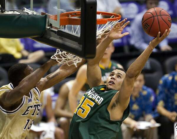 USF's Cole Dickerson (right) who had 19 points and nine rebounds, is fouled by Lester Wilson. Photo: Eugene Tanner, Associated Press