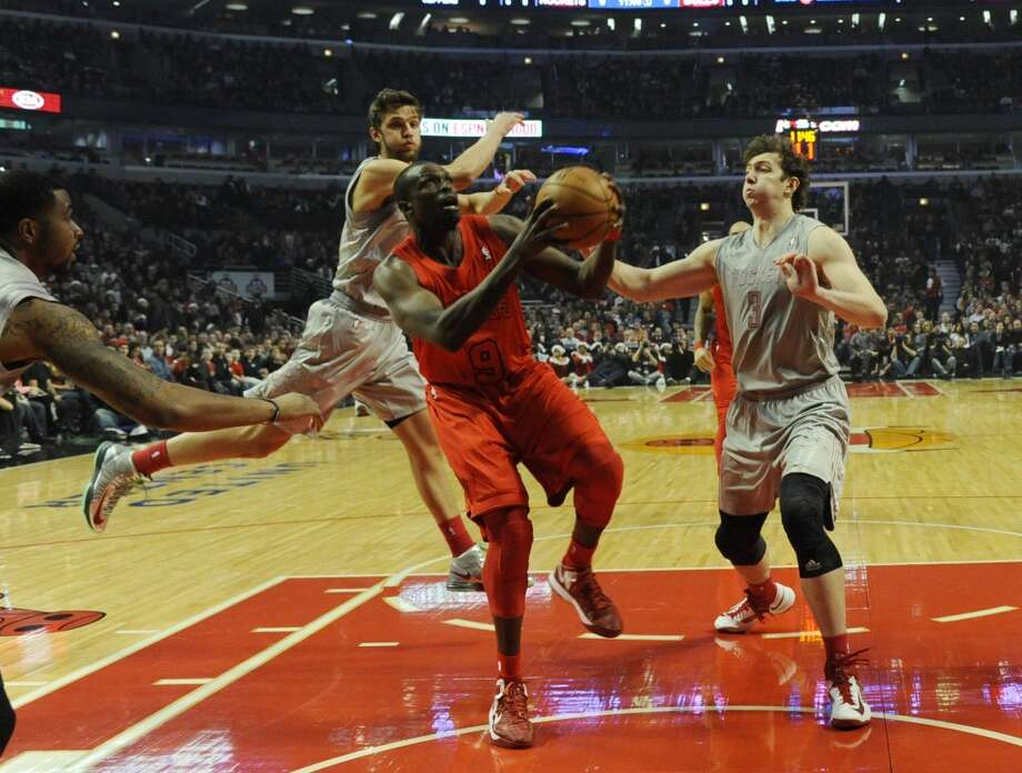 Bulls forward Luol Deng drives to the hoop. (David Banks / Getty Images)