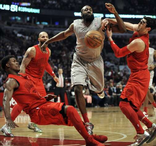 James Harden, center, battles Bulls guard Kirk Hinrich, right, and forward Jimmy Butler, left, for a loose ball during the first quarter. (Paul Beaty / Associated Press)