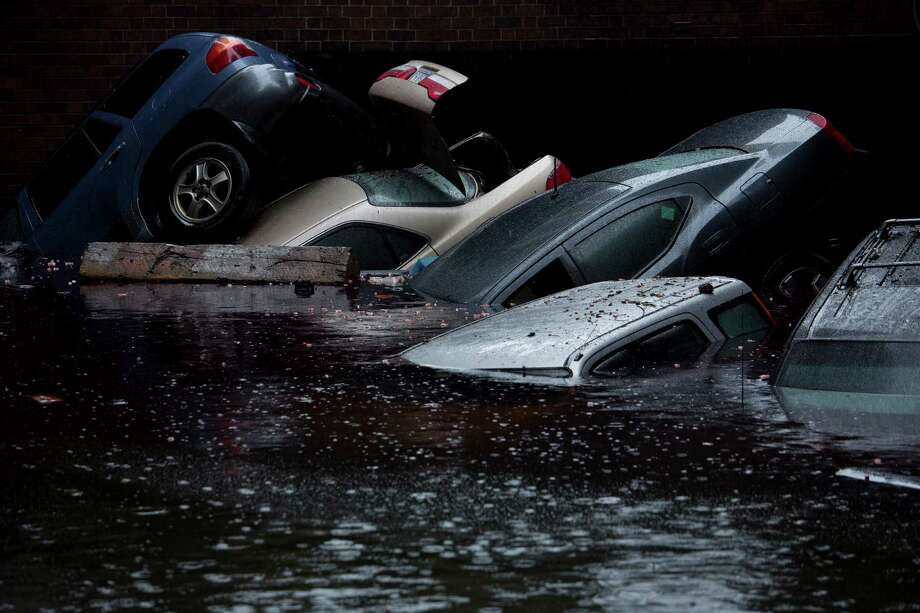 A parking garage in the Wall Street area under floodwaters in the Manhattan borough of New York, Oct. 30, 2012. Hurricane Sandy moved inland Tuesday after grinding life to a halt for millions of people in more than a half-dozen states, leaving behind the daunting task of cleaning up. (Damon Winter/The New York Times) Photo: DAMON WINTER / NYTNS