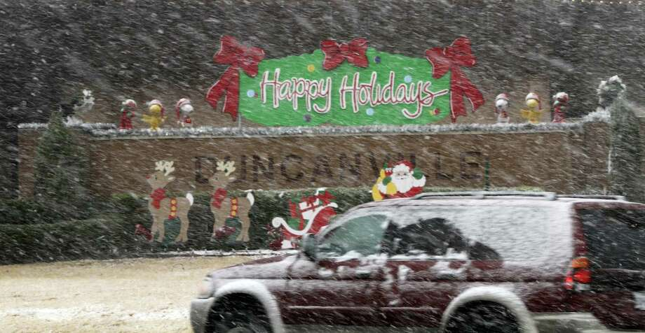 Christmas Day snow falls on Main Street near the Duncanville Police Department in Duncanville, Texas on Tuesday, Dec. 25, 2012. Photo: Irwin Thompson, Associated Press / Dallas Morning News