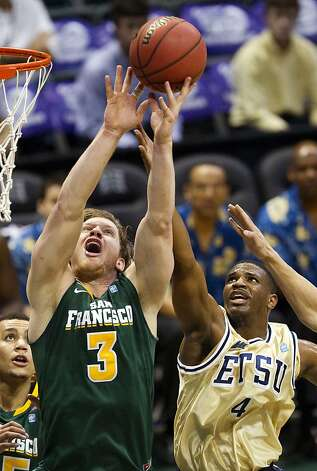 San Francisco forward Matt Christiansen (3) battles East Tennessee State guard Rashawn Rembert (4) for a rebound in the first half of an NCAA college basketball game at the Diamond Head Classic, Tuesday, Dec. 25, 2012, in Honolulu. (AP Photo/Eugene Tanner) Photo: Eugene Tanner, Associated Press