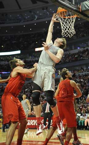Omer Asik looks to score two of his 20 points. (David Banks / Getty Images)