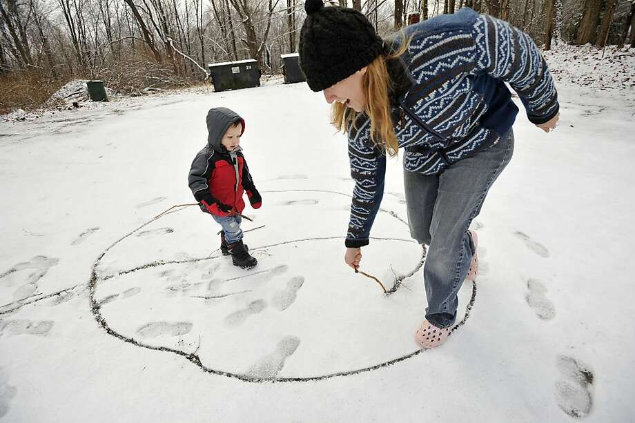 One-year-old Lucian Heydt-Moorash plays in the snow with his mother, Ava Heydt, in the parking lot of the Sandy Hook Diner in the Sandy Hook section of Newtown on Tuesday, Dec. 25, 2012. Photo: Jason Rearick
