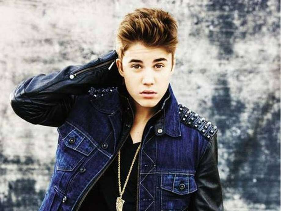 Top Artists - 5. Justin Bieber. His third studio album, 'Believe' was released in June,  debuting at number one on the Billboard 200. (Island)