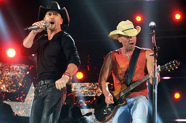 Highest-Grossing Tours - 7. Tim McGraw and Kenny Chseney | Total Gross: $96.5 million | Number of Shows: 23 | Total Attendance: 1,085,382 (Kevin Winter / Getty Images) Photo: Kevin Winter/ACMA2012 / 2012 Kevin Winter/ACMA2012