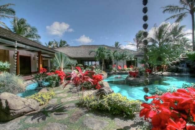 Pool surrounded by tropical plants (Courtesy of David Dunham)