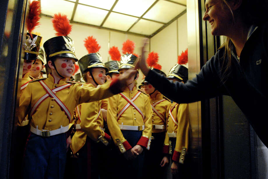 Grayson Kelley, 10, gets a high five from her mom, Jennifer, as just before the elevator closes and the soldiers head up to take the stage in the New York City Ballet's Nutcracker at Lincoln Center in New York, NY, Dec. 20, 2012. Photo: Keelin Daly / Stamford Advocate Riverbend Stamford, CT