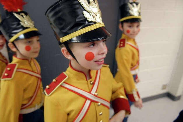 Grayson Kelley, 10, center, prepares to take the stage as a soldier in the New York City Ballet's Nutcracker at Lincoln Center in New York, NY, Dec. 20, 2012. Photo: Keelin Daly / Stamford Advocate Riverbend Stamford, CT