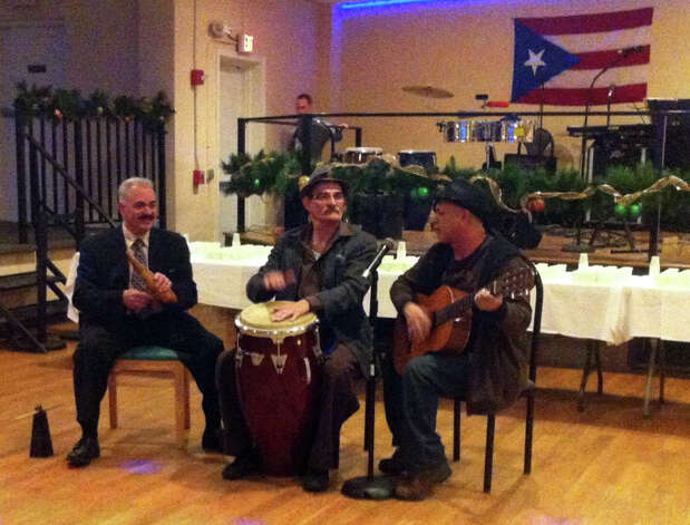 Johnny Rios (playing the güiro), Noë Alicea (playing the conga) and Jose Sanchez (playing the guitar) perform during the Puerto Rican Parade of Fairfield Countyís fifth annual coquito contest. Coquito is an eggnog-like drink containing rum and coconut. Photo: Keila Torres Ocasio