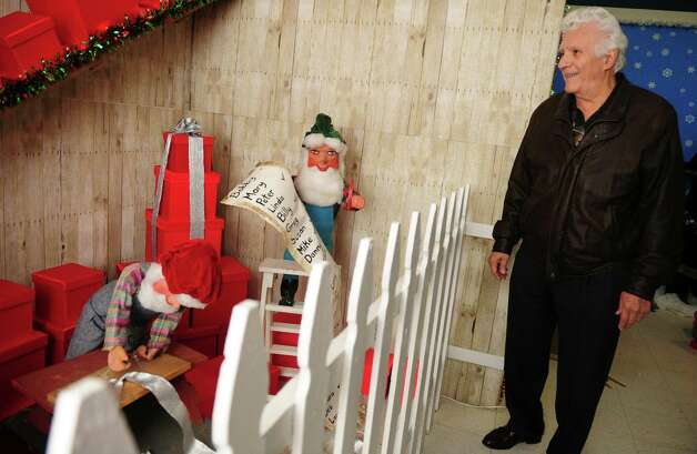 Former Bridgeport Mayor Leonard Paoletta looks around the Christmas Village, run by the Bridgeport Police Athletic League (PAL), Thursday, Nov. 29, 2012 in Trumbull, Conn.  The village is opening for the season on Saturday.  Paoletta was in office in 1982, the year the Christmas Village burned down and he helped rally the community to rebuild the village. Photo: Autumn Driscoll / Connecticut Post
