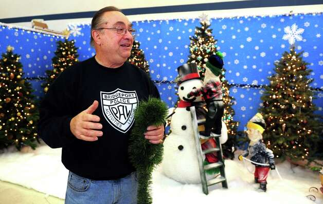 Mike Marella sets up the Christmas Village, run by the Bridgeport Police Athletic League (PAL), Thursday, Nov. 29, 2012 in Trumbull, Conn.  The village is opening for the season on Saturday. Photo: Autumn Driscoll / Connecticut Post