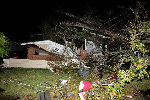 A house in the Midtown section of Mobile, Ala. is damaged after a tornado touched down Tuesday, Dec. 25, 2012. A Christmas Day twister outbreak left damage across the Deep South while holiday travelers in the nation's much colder midsection battled sometimes treacherous driving conditions from freezing rain and blizzard conditions. (AP Photo/AL.com, Mike Kittrell)  MAGS OUT Photo: Mike Kittrell, MBI / AL.com