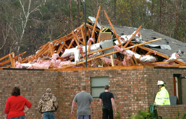 A house in Tioga, La., is severely damaged after an apparent tornado tore through the area Tuesday, Dec. 25, 2012. (AP Photo/The Daily Town Talk, Melinda Martinez)  NO SALES Photo: Melinda Martinez, MBO / The Daily Town Talk