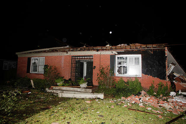 A home in the Midtown section of Mobile, Ala. is damaged after a tornado touched down Tuesday, Dec. 25, 2012. A Christmas Day twister outbreak left damage across the Deep South while holiday travelers in the nation's much colder midsection battled sometimes treacherous driving conditions from freezing rain and blizzard conditions. (AP Photo/AL.com, Mike Kittrell)  MAGS OUT Photo: Mike Kittrell, MBI / AL.com