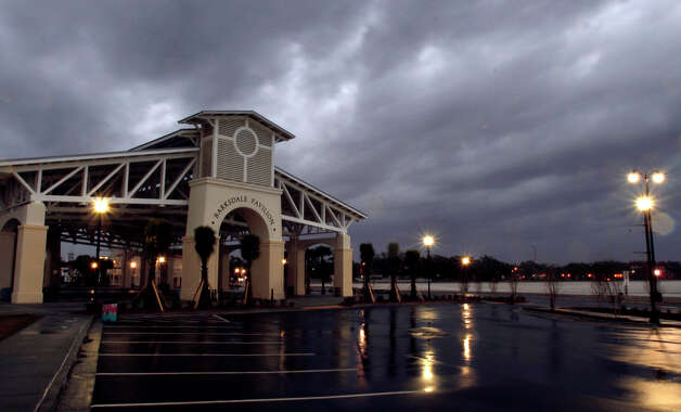 Storm clouds roll past Barksdale Pavilion at Jones Park in Gulfport, Miss., Tuesday, Dec. 25, 2012. After most of spending Christmas Day with a blustery day and occasional blue skies, storm clouds arrived on the Coast at 4 p. m. The strong south breeze blew most of the bad weather north of the immediate coast line. (AP Photo/The Sun Herald, Tim Isbell) Photo: Tim Isbell, MBR / The Sun Herald
