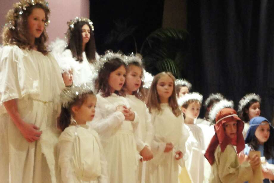 A chorus of angels heralds Joseph and Mary in the Natvity pageant staged Saturday at St. Pius X School.  Fairfield CT 12/15/12 Photo: Meg Barone / Fairfield Citizen freelance