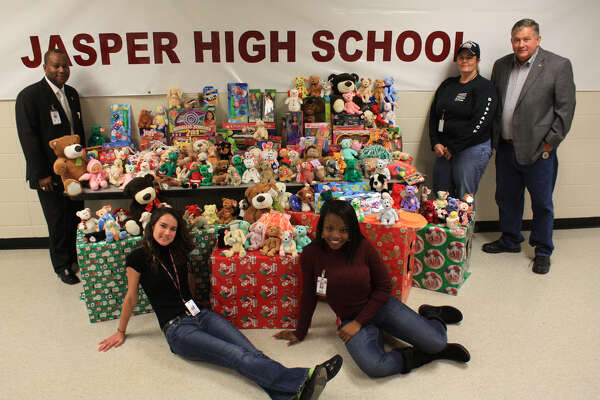 Pictured: Kaela Collin, front right, with toy drive assistant Riley Hines; Laura Moore of Blue Santa; Jasper County Sheriff Mitchell Newman; and JHS Principal Mr. Williams, back left.