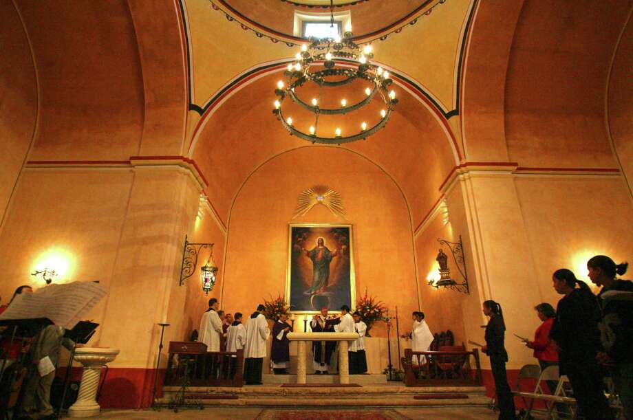 San Antonio Archbishop Jose Gomez (center, hands raised) blesses the altar at Mission Concepción, Sunday, March 21, 2010. The interior of the church has been restored and repainted in its original Spanish colonial color scheme. Photo: File Photo, San Antonio Exrpress-News / jdavenport@express-news.net