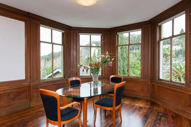 The formal dining room looks out at mature trees and a rolling hill. Photo: Peter Lyons/Peter Lyons Photogra