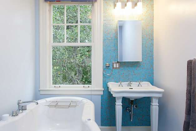 Decorative tile work can be found in the kitchen and bathrooms. Photo: Peter Lyons/Peter Lyons Photogra