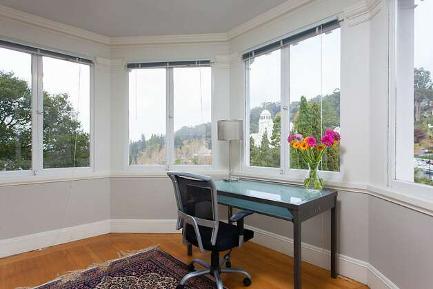 Angled windows that frame hillside views can be found throughout the home. Photo: Peter Lyons/Peter Lyons Photogra