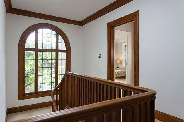 Hardwood details such as crown molding and arches decorate the home. Photo: Peter Lyons/Peter Lyons Photogra