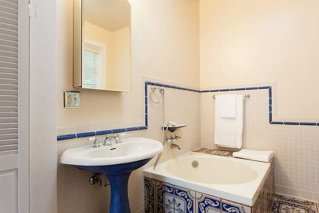 The recently remodeled master bathroom has a soaking tub.  Photo: Peter Lyons/Peter Lyons Photogra