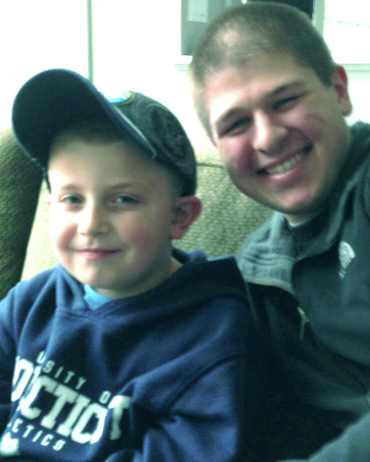 Luke Christos, 6, of New Milford poses Nov. 12, 2012 with his pen pal, Jamie Hunt, OSSN, also from New Milford.  Courtesy of the Christos family Photo: Contributed Photo
