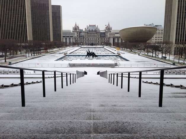 Snow covers the Empire State Plaza on Tuesday in Albany. (Paul Buckowski / Times Union) Photo: Paul Buckowski