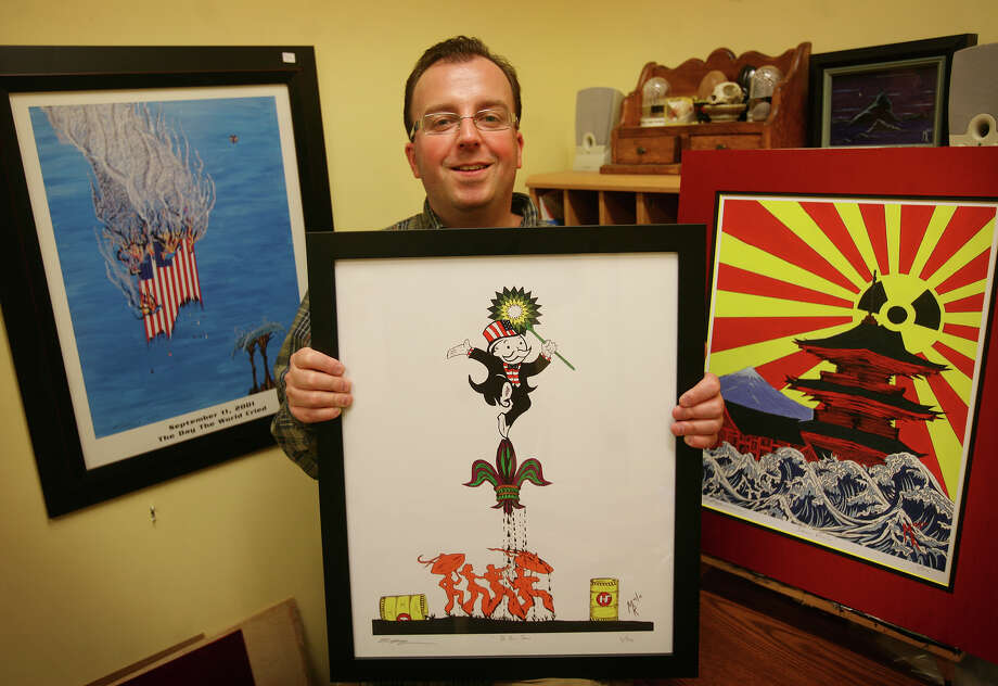 Artist Matt Roe of Trumbull regularly makes artworks that illustrate news events, including the September 11 attacks, the BP oil spill, and the Japanese tsunami. Roe said he is planning a painting to illustrate the fiscal cliff issue, featuring a tug-of-war between Republicans and Democrats. Photo: Brian A. Pounds / Connecticut Post