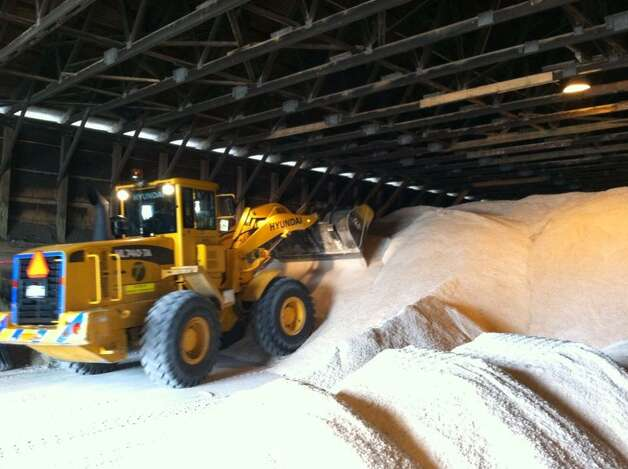According to Don Cleveland, a front-loader operator for the state Department of Transportatoin, said the state will probably go through 500 tons of road salt during the storm. Cleveland was loading up at a DOT garage at the corner of Route 155 and the Northway in Colonie. (SKIP DICKSTEIN / TIMES UNION)