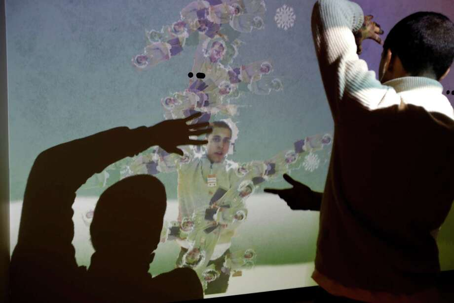 "Bronx Preparatory Charter School student Pablo Flores experiments with an exhibit called the ""Human Tree"" at the new National Museum of Mathematics in New York, Monday, Dec. 17, 2012. The museum is aimed at kids aged 8 to 13, and curators have given the place a playground feel. The 40 exhibits include a ""wall of fire"" made up of laser lights that teaches kids about geometry and a square-wheeled tricycle that still manages to produce a smooth ride thanks to a wavy track. Photo: Seth Wenig, AP / AP"