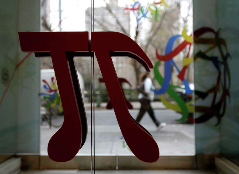 "A door handle in the shape of pi is seen at the new National Museum of Mathematics in New York, Monday, Dec. 17, 2012. The museum is aimed at kids aged 8 to 13, and curators have given the place a playground feel. The 40 exhibits include a ""wall of fire"" made up of laser lights that teaches kids about geometry and a square-wheeled tricycle that still manages to produce a smooth ride thanks to a wavy track. Photo: Seth Wenig, AP / AP"