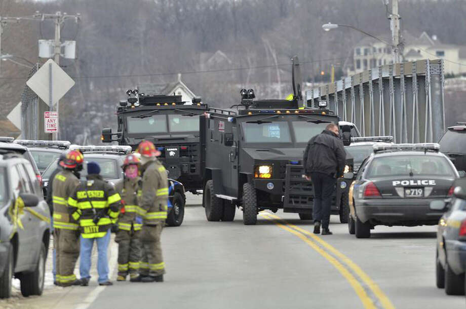 Swat teams appear at the scene of a fire in Webster, N.Y., Monday, Dec. 24, 2012. Police in New York state say a man who killed two firefighters in a Christmas Eve ambush had served 17 years for manslaughter in the death of his grandmother. Photo: Seth Binnix, AP / Messenger Post Media