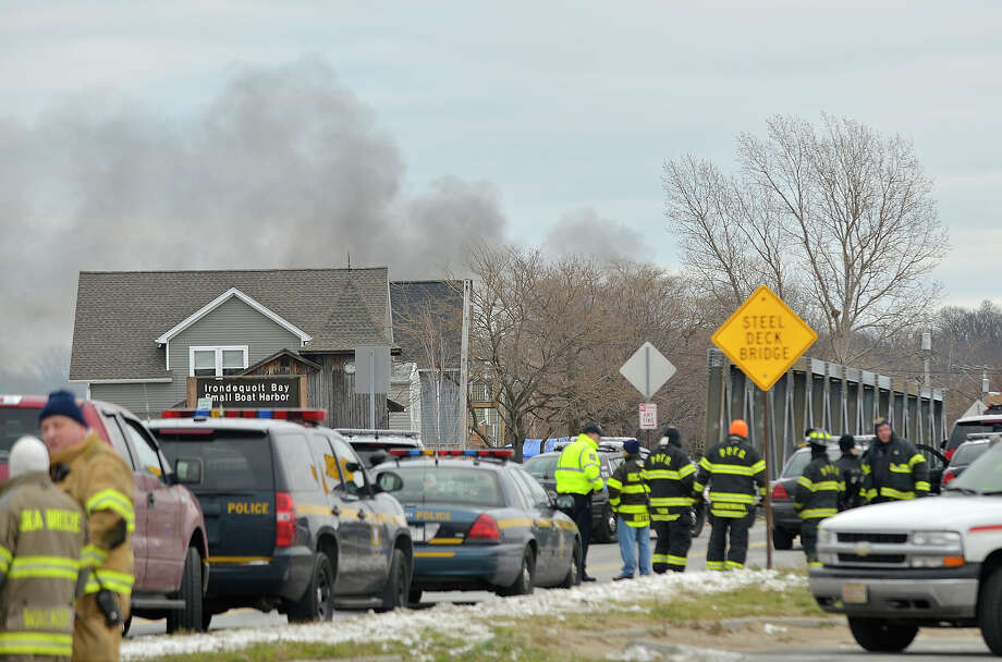 Smoke is seen from the site of a fire in Webster, N.Y., Monday, Dec. 24, 2012. Police in New York state say a man who killed two firefighters in a Christmas Eve ambush had served 17 years for manslaughter in the death of his grandmother. Photo: Seth Binnix, AP / Messenger Post Media