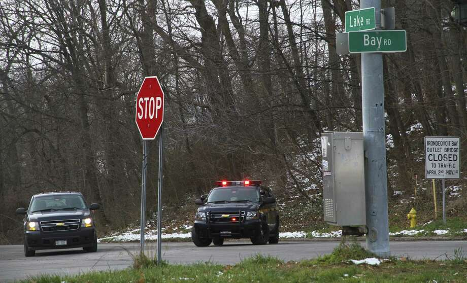 WEBSTER, NY - DECEMBER 24:  Police officers man a road block on Lake Road following two firefighters killed, and two injured in a presumed ambush attack December 24, 2012 in Webster, New York. Authorities say an ex-con gunned down two firefighters after setting a car and a house on fire early Monday, then took shots at police and committed suicide while several homes burned. Photo: Guy Solimano, Getty Images / 2012 Getty Images